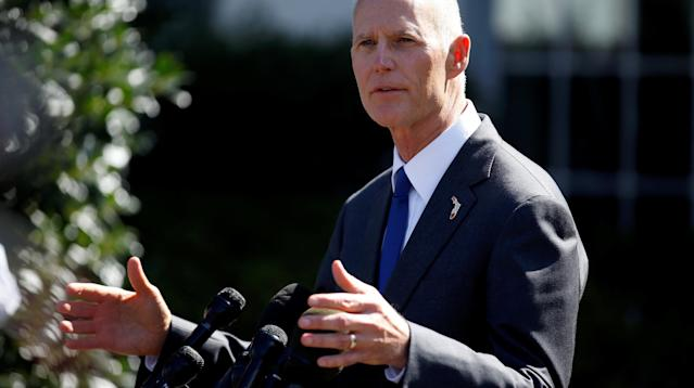 Florida Gov. Rick Scott Signs Gun Bill That Arms Some School Staff Into Law