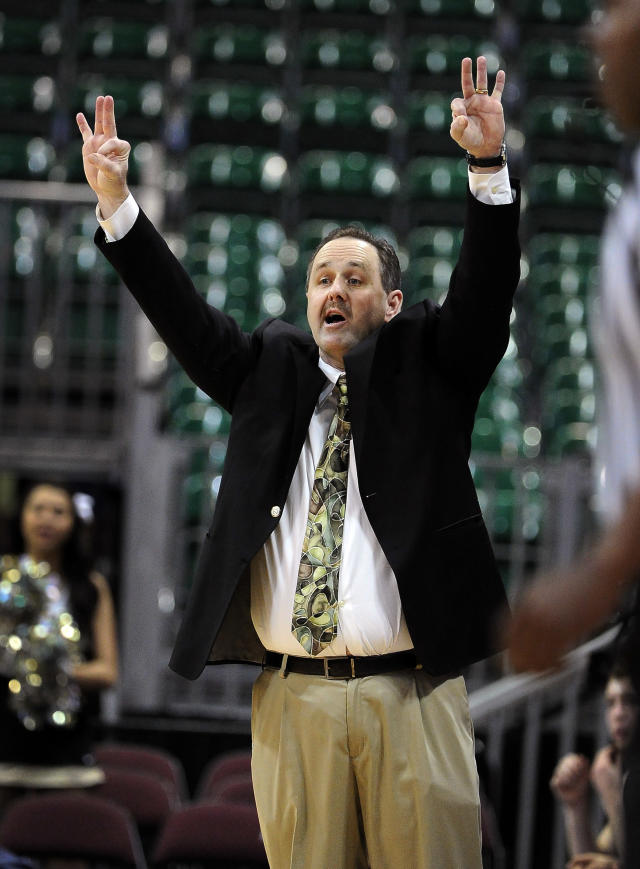 Idaho coach Don Verlin calls to his team during the second half of an NCAA college men's basketball game against Utah Valley in the semifinals of the West Athletic Conference tournament Friday, March 14, 2014, in Las Vegas. Idaho won 74-69. (AP Photo/David Becker)