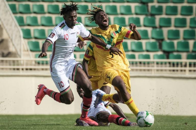 Kenneth Muguna (L) of Kenya and Rominigue Kouame (R) of Mali contest possession during a World Cup qualifier in Nairobi on Sunday (AFP/Yasuyoshi CHIBA)