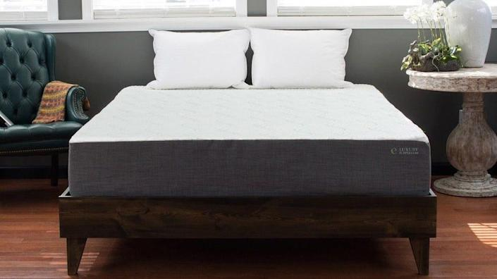 The pinewood frame and mid-century modern style make Kotter Home's platform bed a solid sleeping option.
