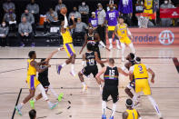 Los Angeles Lakers' LeBron James (23) shoots against the Denver Nuggets during the first half of an NBA conference final playoff basketball game Thursday, Sept. 24, 2020, in Lake Buena Vista, Fla. (AP Photo/Mark J. Terrill)