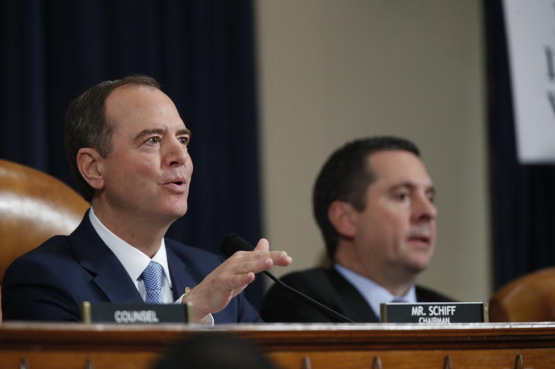 House Intelligence Committee Chairman Adam Schiff, D-Calif., questions former White House national security aide Fiona Hill, and David Holmes, a U.S. diplomat in Ukraine, testify before the House Intelligence Committee on Capitol Hill in Washington, Thursday, Nov. 21, 2019, during a public impeachment hearing of President Donald Trump's efforts to tie U.S. aid for Ukraine to investigations of his political opponents, as Rep. Devin Nunes, R-Calif, the ranking member of the House Intelligence Committee, looks on. (AP Photo/Alex Brandon)