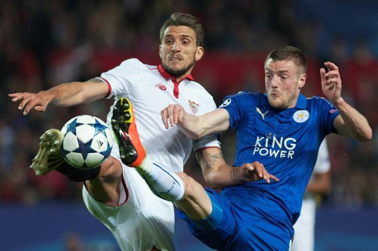 Sevilla's Daniel Carrico (L) vies with Leicester City's Jamie Vardy during their Champions League round of 16 second leg in Sevilla, southern Spain on February 22, 2017