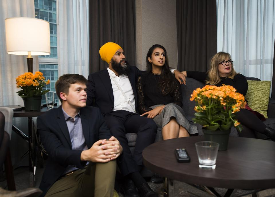NDP Leader Jagmeet Singh. second left, and his wife Gurkiran Kaur, second right, watch the Canadian election results come in at his hotel room during in Burnaby, B.C., on Monday, October 21, 2019. THE CANADIAN PRESS/Nathan Denette
