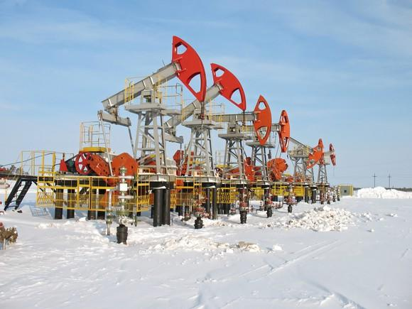 A row of oil pumps in the snow.