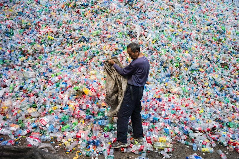 China has long been the world's dumping ground for waste, with Europe and North America exporting millions of tonnes of recyclable rubbish to the country every year (AFP Photo/FRED DUFOUR)