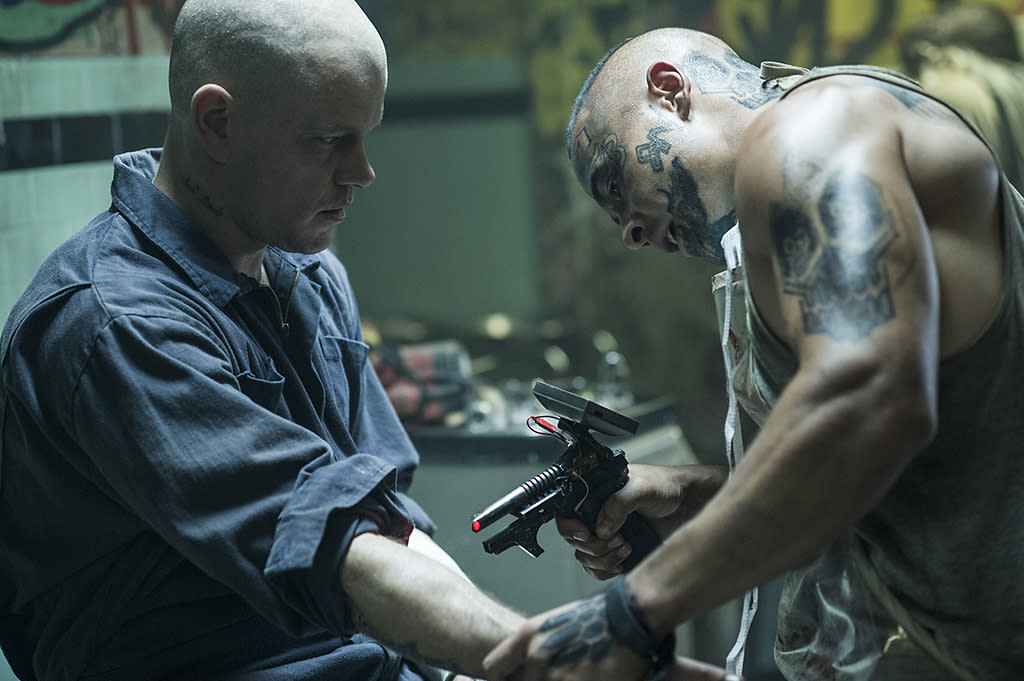 Sandro (JOSE PABLO CANTILLO, right) preps Max (MATT DAMON) for surgery inside Spider's Lair in TriStar Pictures' ELYSIUM.