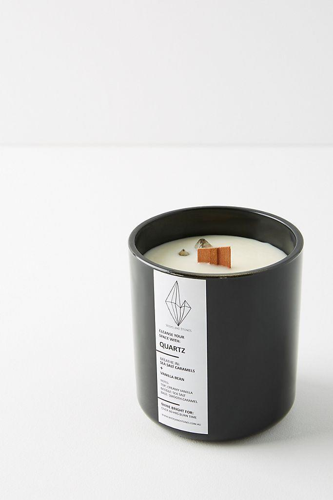 """<p><strong>Wicks and Stones Anthropologie</strong></p><p>anthropologie.com</p><p><strong>$38.40</strong></p><p><a href=""""https://go.redirectingat.com?id=74968X1596630&url=https%3A%2F%2Fwww.anthropologie.com%2Fshop%2Fwicks-and-stones-infinity-candle&sref=https%3A%2F%2Fwww.oprahmag.com%2Flife%2Fg27562264%2Fbest-fall-scented-candles%2F"""" rel=""""nofollow noopener"""" target=""""_blank"""" data-ylk=""""slk:Shop Now"""" class=""""link rapid-noclick-resp"""">Shop Now</a></p><p>Not only does this candle have the sweet scents of salted caramel and vanilla, but it also comes with a quartz stone that inspires positive energy and healing. </p>"""