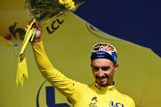 Julian Alaphilippe is the first Frenchman to wear the leader's yellow jersey since Tony Gallopin in 2014 (AFP Photo/Anne-Christine POUJOULAT )