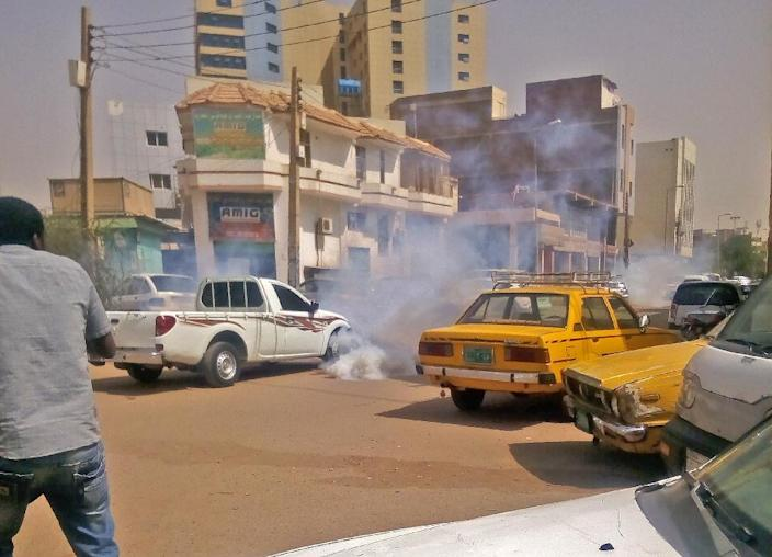 Tear gas smoke is seen amidst cars after Sudanese security forces used it to disperse protesters taking part in an anti-government demonstration in Khartoum on February 14, 2019 (AFP Photo/-)