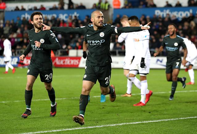 David Silva celebrates one of his two goals against Swansea on Wednesday. (Getty)
