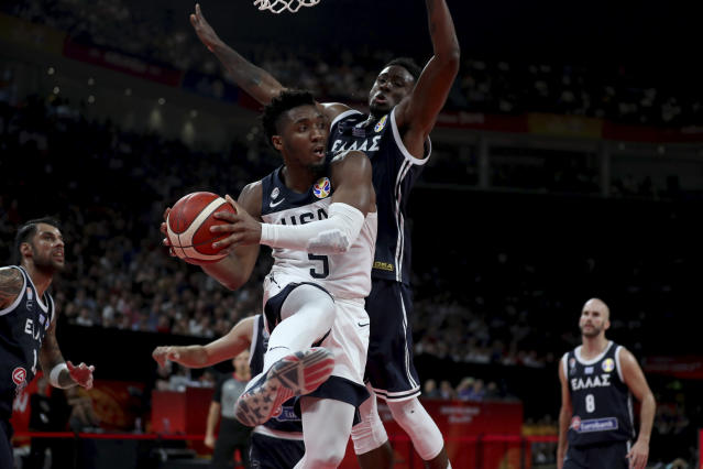 United States' Donovan Mitchell keeps the ball from Greece's Thanasis Antetokounmpo during phase two of the FIBA Basketball World Cup at the Shenzhen Bay Sports Center in Shenzhen in southern China's Guangdong province on Saturday, Sept. 7, 2019. United States beat Greece 69-53. (AP Photo/Ng Han Guan)