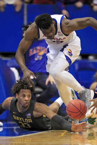 Baylor forward Freddie Gillespie (33) reaches for the ball under Kansas center Udoka Azubuike (35) during the first half of an NCAA college basketball game in Lawrence, Kan., Saturday, Jan. 11, 2020. (AP Photo/Orlin Wagner)