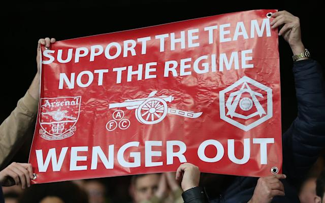 Arsenal fans protest against manager Arsene Wenger of Arsenal Credit: REX