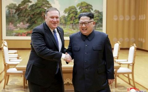 <span>North Korean leader Kim Jong Un shakes hands with US Secretary of State Mike Pompeo</span> <span>Credit: KCNA </span>