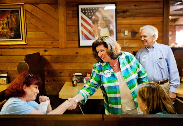 <p>Karen Handel, Republican candidate for Georgia's 6th congressional district, center, greets diners during a campaign stop at Old Hickory House in Tucker, Ga., Monday, June 19, 2017. (Photo: David Goldman/AP) </p>
