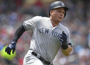New York Yankees' Luke Voit runs after hitting a 2-run double off Cleveland Indians starting pitcher Shane Bieber in the second inning of a baseball game, Sunday, June 9, 2019, in Cleveland. (AP Photo/David Dermer)