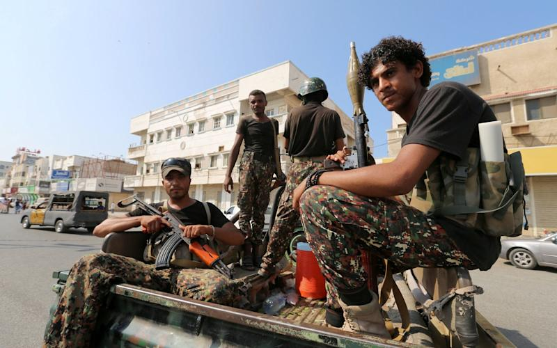 Houthi militants patrol a street in Hodeidah - REUTERS