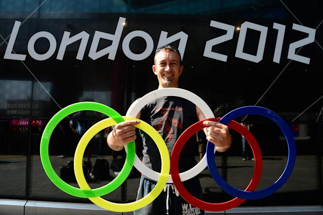 A Juggler poses with Olympic rings outside the Stratford Tube Station on July 26, 2012 in London, England. (Photo by Pascal Le Segretain/Getty Images)