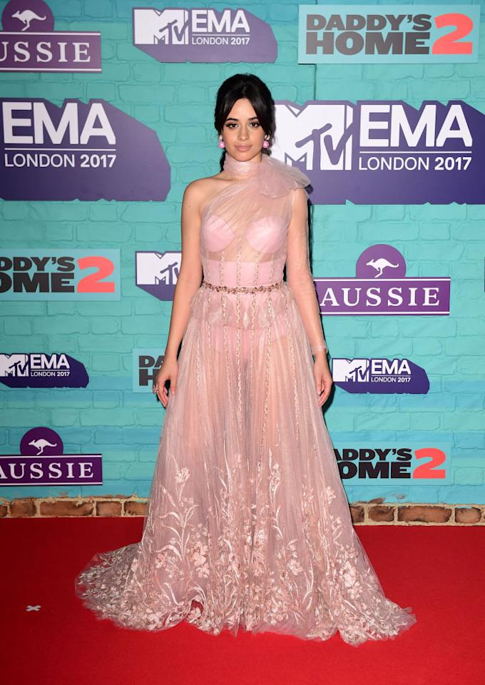 <p>Camila Cabello had a full princess moment in a pink tulle gown with a big bow. (Photo: Getty Images) </p>