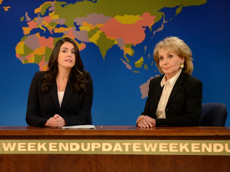 """This May 10, 2014 photo released by NBC shows cast member Cecily Strong, left, with TV personality Barbara Walters during an appearance on the Weekend Update segment of """"Saturday Night Live,"""" in New York. On Friday, May 16, 2014, capping a spectacular half-century run she began as the so-called """"Today"""" Girl, Walters will exit ABC's """"The View."""" Behind the scenes she will remain as an executive producer of the New York-based talk show she created 17 years ago, and make ABC News appearances as events warrant and stories catch her interest. Walters has often been parodied on the weekly sketch comedy series. (AP Photo/NBC, Dana Edelson)"""