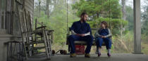"""This image released by Apple shows Justin Timberlake, left, and Ryder Allen in a scene from """"Palmer."""" (Apple via AP)"""