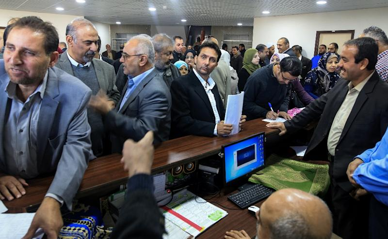 Palestinian Authority employees gather to return to work at the headquarters of the finance ministry in Gaza City on November 29, 2017