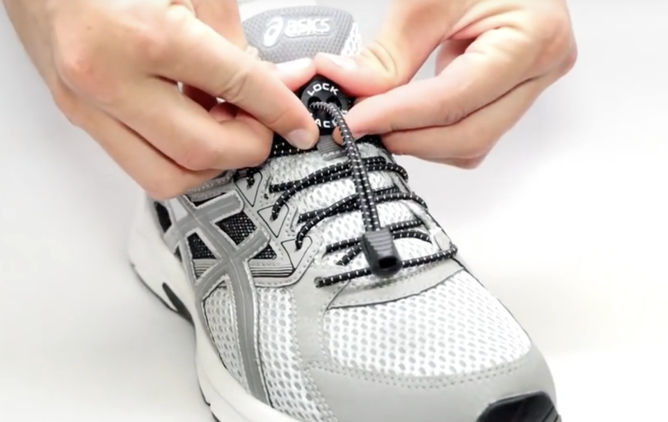 To open or close the LaceLocks, you press the spring-loaded clasp and slide it along the laces.