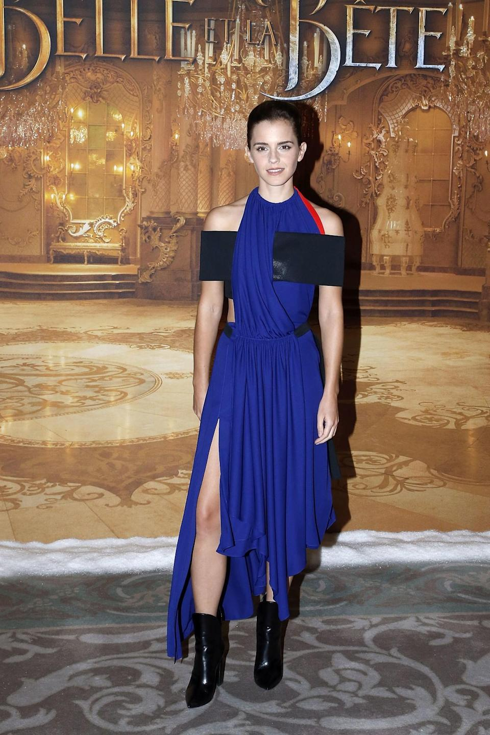 <p>In Paris, Emma worked a striking Louis Vuitton dress, paired with black boots. <em>[Photo: Getty]</em> </p>