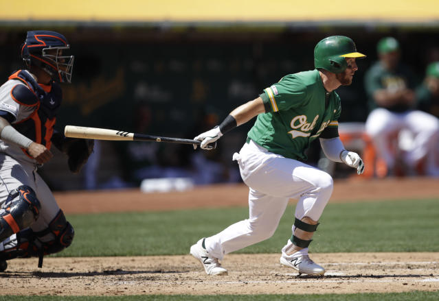 Oakland Athletics' Robbie Grossman watches his RBI single against the Houston Astros during the third inning of a baseball game Saturday, Aug. 17, 2019, in Oakland, Calif. (AP Photo/Ben Margot)