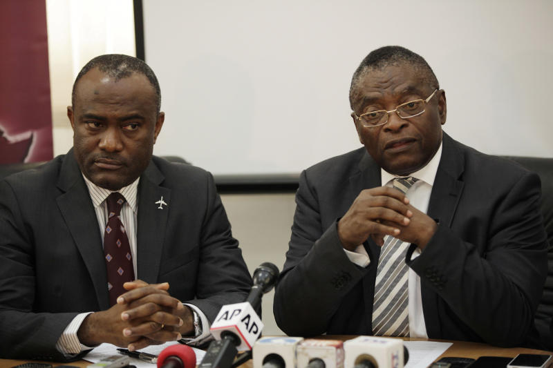 Vice chairman Arik Air Nigeria, Senator Aniete Okon, right, and managing director, Chris Ndulue, left, speak to journalists during a press conference in Lagos, Nigeria. Thursday, Sept. 20, 2012. Nigeria's largest airline Arik Air Ltd. halted all its domestic flights indefinitely Thursday as its leaders alleged government corruption made it impossible for the carrier to fly, after officials raided and disrupted its flights without explanation. (AP Photo/Sunday Alamba)