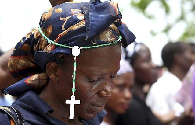 A Christian woman wears a rosary at a procession during a ritual to mark the death of Jesus Christ on Good Friday in Nigeria's commercial capital Lagos, in this April 10, 2009 file picture.