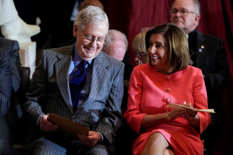 U.S. House Speaker Pelosi (D-CA) and Senate Majority Leader McConnell (R-KY) sit next to each other during a Congressional Gold Medal Award ceremony for Steve Gleason at the U.S. Capitol in Washington