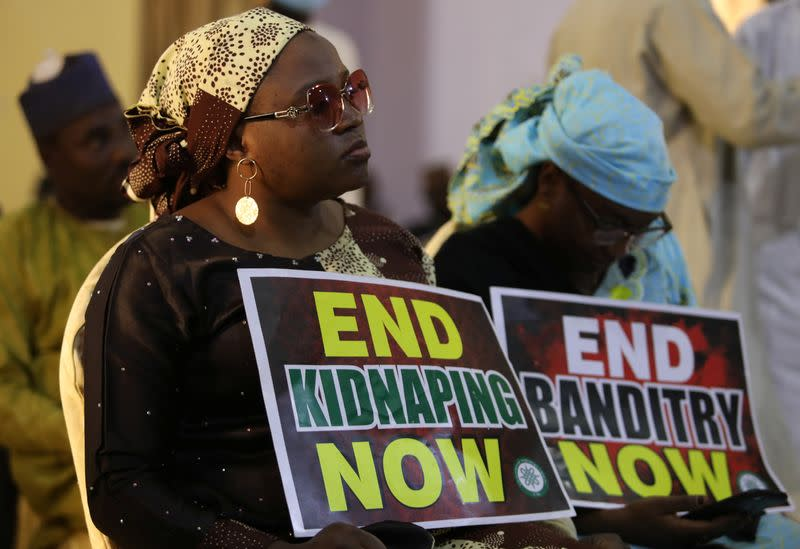 A demonstrator holds a sign during a protest to urge authorities to rescue hundreds of abducted schoolboys, in northwestern state of Katsina