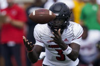 Louisville quarterback Malik Cunningham reaches for a wild snap during the first half of an NCAA college football game against Wake Forest on Saturday, Oct. 2, 2021, in Winston-Salem, N.C. (AP Photo/Chris Carlson)