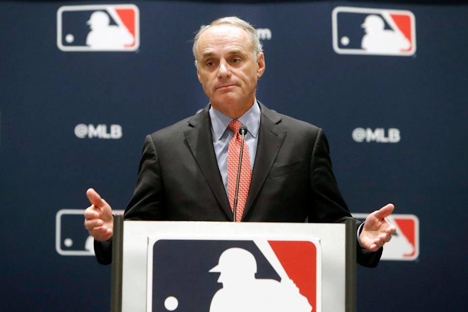 Rob Manfred speaks to the media at the owners meeting in 2019.