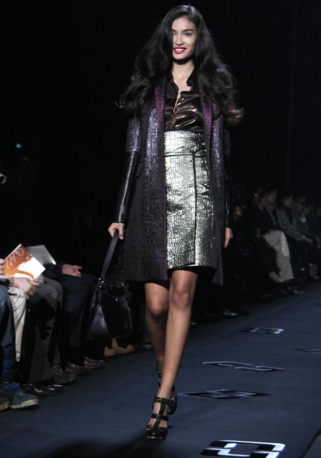 <b>Diane Von Furstenburg AW 13 runway show<br><br></b>Metallic dresses, shimmering coats and a flash of pillarbox-red lipstick gave a nod to the futuristic trend of the moment.<br><br>©Rex