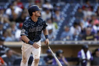 San Diego Padres' Wil Myers watches his walkoff single during the tenth inning of a baseball game against the Colorado Rockies, Sunday, Sept. 8, 2019, in San Diego. (AP Photo/Gregory Bull)