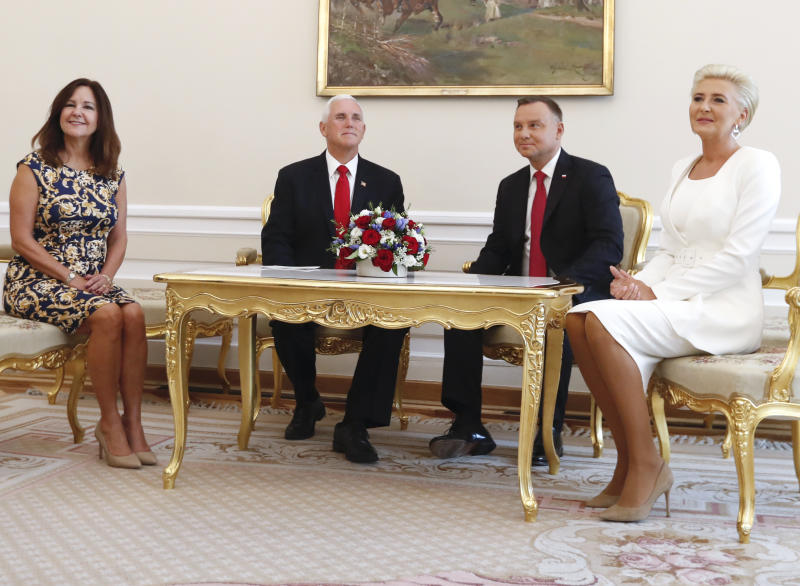 U.S. Vice President Mike Pence and his wife, Karen, left, pose together with Polish President Andrzej Duda and his wife Agata Kornhauser-Duda, in Warsaw, Poland, Monday, Sept. 2, 2019. (AP Photo/Petr David Josek)