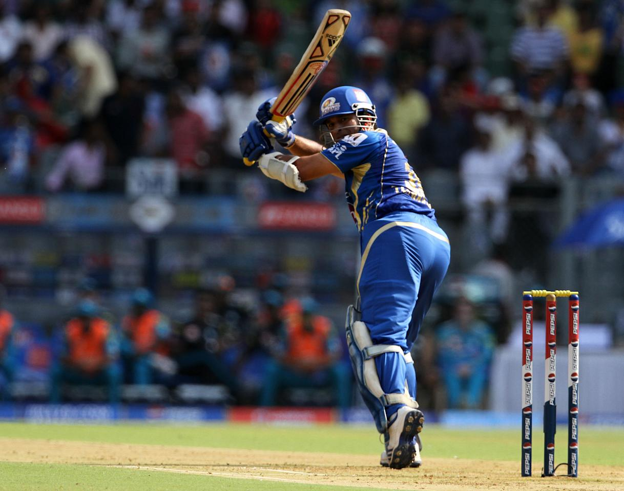 Mumbai Indian player Sachin Tendulkar plays a shot during match 15 of the Pepsi Indian Premier League ( IPL) 2013  between The Mumbai Indians and the Pune Warriors India held at the Wankhede Stadium in Mumbai on the 13th April 2013 ..Photo by Vipin Pawar-IPL-SPORTZPICS  ..Use of this image is subject to the terms and conditions as outlined by the BCCI. These terms can be found by following this link:..https://ec.yimg.com/ec?url=http%3a%2f%2fwww.sportzpics.co.za%2fimage%2fI0000SoRagM2cIEc&t=1502897800&sig=zRaQQckwVMpmwq_DpaN8jA--~C