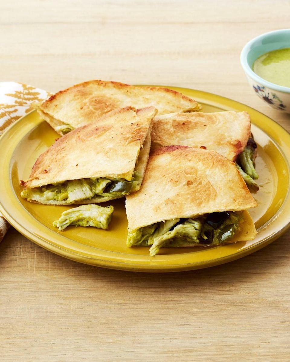"""<p>These chicken quesadillas are baked in the oven, ensuring a crispy tortilla and a gooey inside.</p><p><strong><a href=""""https://www.thepioneerwoman.com/food-cooking/recipes/a32390129/lime-chicken-quesadillas-recipe/"""" rel=""""nofollow noopener"""" target=""""_blank"""" data-ylk=""""slk:Get the recipe."""" class=""""link rapid-noclick-resp"""">Get the recipe.</a></strong> </p>"""