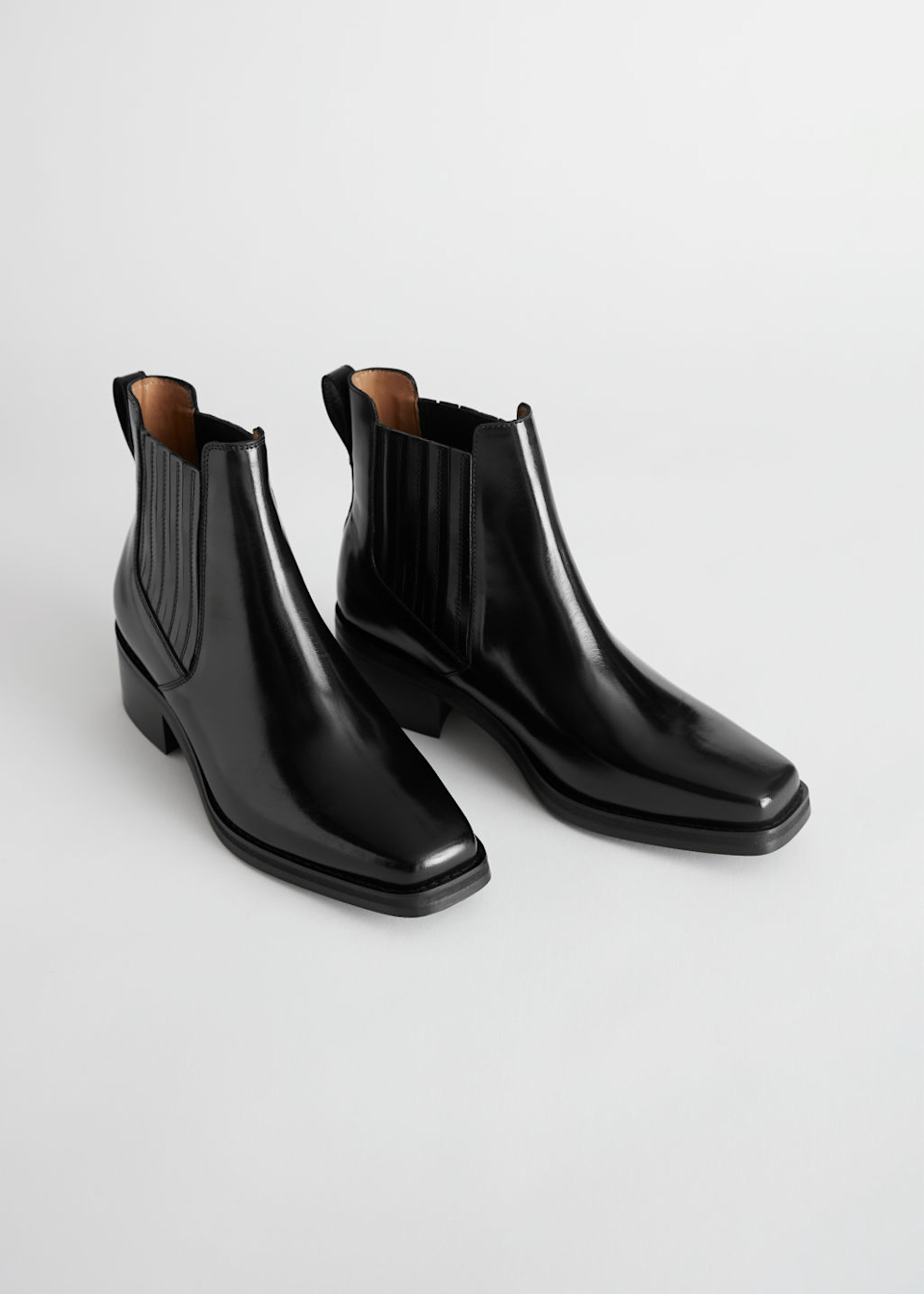 """<h3>Square Toe</h3><br>We're welcoming this '90s-inspired silhouette back for fall, and you can find it in a variety of styles. Use it to add a dose of vintage flair to any look.<br><br><strong>& Other Stories</strong> Square Toe Leather Ankle Boots, $, available at <a href=""""https://go.skimresources.com/?id=30283X879131&url=https%3A%2F%2Fwww.stories.com%2Fen_usd%2Fshoes%2Fboots%2Fchelseaboots%2Fproduct.square-toe-leather-ankle-boots-black.0817653001.html"""" rel=""""nofollow noopener"""" target=""""_blank"""" data-ylk=""""slk:& Other Stories"""" class=""""link rapid-noclick-resp"""">& Other Stories</a>"""