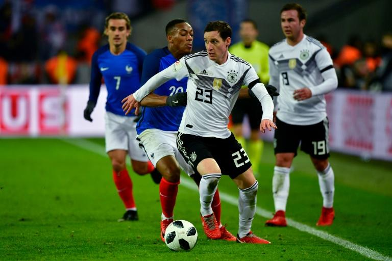 Germany's midfielder Sebastian Rudy (R) and France's forward Anthony Martial vie for the ball during the international friendly football match November 14, 2017