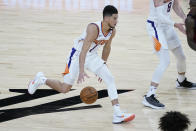 Phoenix Suns guard Devin Booker (1) looks to pass against the Cleveland Cavaliers during the second half of an NBA basketball game, Monday, Feb. 8, 2021, in Phoenix. (AP Photo/Matt York)