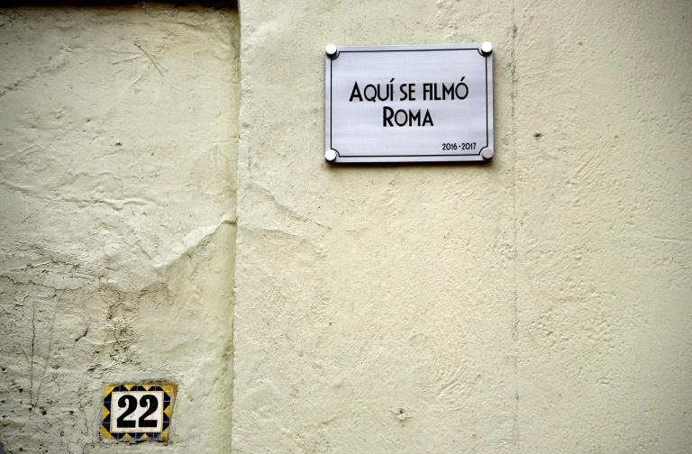 """Outside number 22 Tepeji street a newly installed metal plaque informs visitors: """"This is where 'Roma' was filmed, 2016-2017"""""""