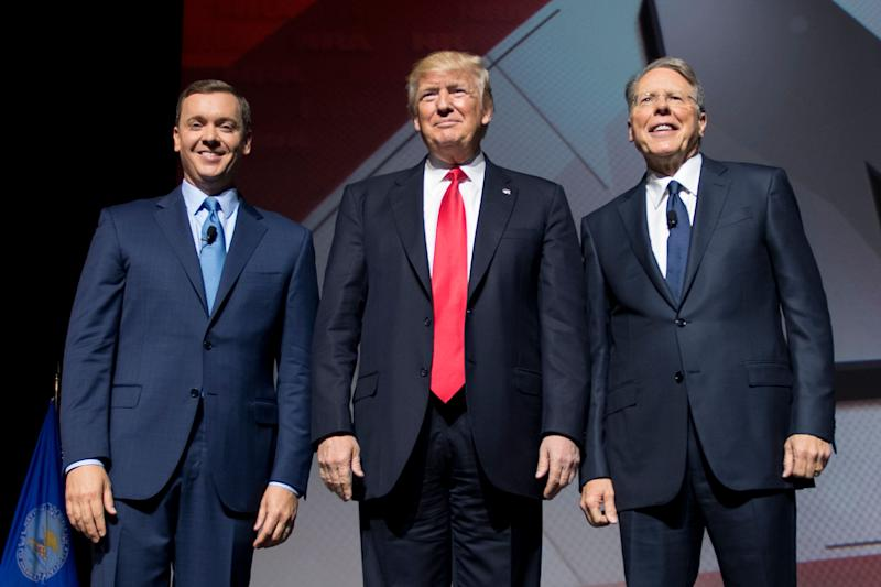 President Donald Trump (center) stands beside NRA CEO and executive vice president Wayne LaPierre (right) and NRA-ILA executive director Chris Cox (left). The NRA donated over $30 million to Trump's presidential campaign in 2016.