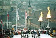 <p>To signify their second Olympic Games, organizers in Innsbruck decided to light two flames during the opening ceremony. The event was held above a dramatic backdrop of the city. Fun fact: A specially designed car with a glass dome allowed passersby to catch a glimpse of the Olympic torch as it made its way across a 932-mile leg of the relay. </p>