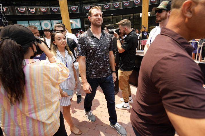Max Scherzer, of the Washington Nationals, arrives to a news conference to be named the National League's starting pitcher for the MLB All-Star baseball game, Monday, July 12, 2021, in Denver. (AP Photo/David Zalubowski)
