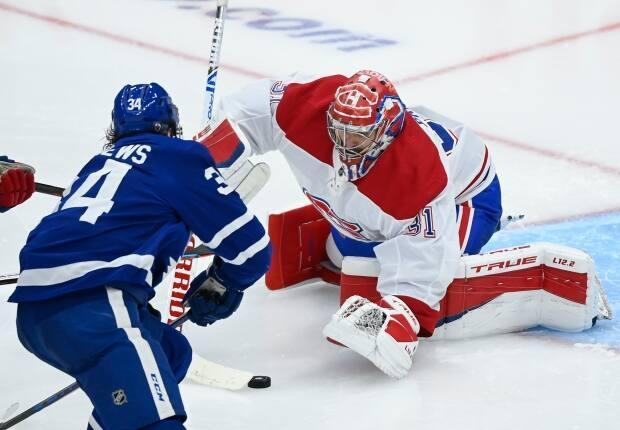 Montreal Canadiens goaltender Carey Price and Maple Leafs forward Auston Matthews are shown earlier in the series in Toronto. Both players will be on the spot in Game 7.   (Nathan Denette/The Canadian Press - image credit)