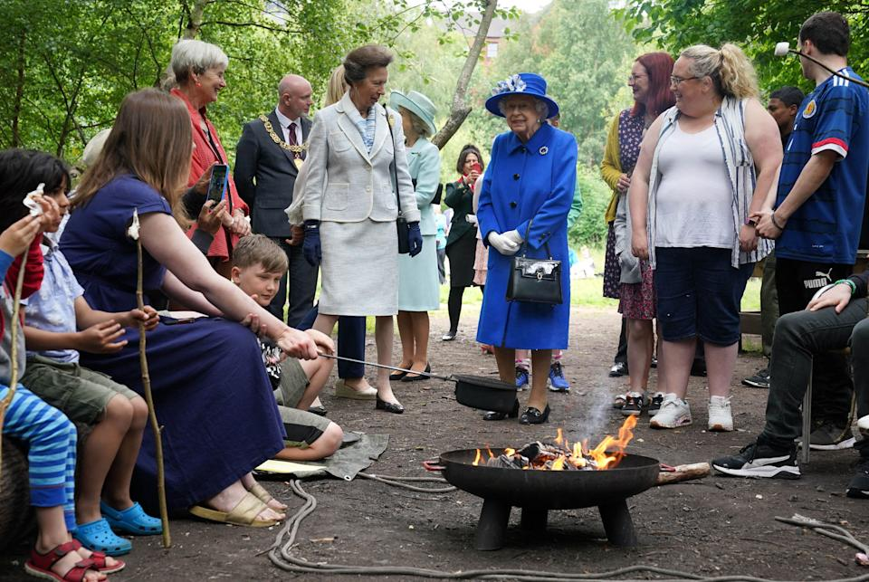 Britain's Queen Elizabeth II and Britain's Princess Anne, Princess Royal meet participants during a visit to The Childrens Wood Project in Glasgow on June 30, 2021, as part of her traditional trip to Scotland for Holyrood Week. (Photo by Andrew Milligan / POOL / AFP) (Photo by ANDREW MILLIGAN/POOL/AFP via Getty Images)
